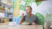 detoks : woman eating in vegetarian restaurants healthy food Stok Video