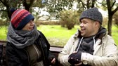 frustrated lady : a homeless couple, a man and woman on a bench in a city park