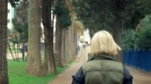 voga : beautiful stylish trendy blond woman walking in a city park in autumn
