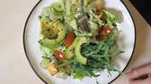 rúcula : fashion food design. vegetable salad with rucolla and avocado