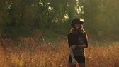 congratulação : Young girl on the meadow in the evening in a hat and laughs welcomes you