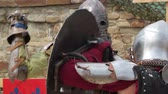knight : a fight between two knights in armor with swords day Stock Footage