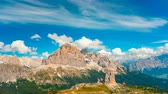 dolomiti : Time Lapse of Dolomites with small white cloud in sky. Summer natural landscape of Fanes Senses Braies national park and Cortina d Ampesso town - travel destination of Northern Italy in time lapse
