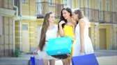 shopaholic : Three graceful cute girl happily walking with fashionable shopping while shoppin