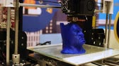 electronics industry : NOVOSIBIRSK, RUSSIA - FEBRUARY 21, 2018: 3d printer print a batman head closeup