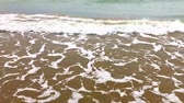 sea bay : Small sea waves with white foam and aquamarine colour near shallow dive, sand beach under water Stock Footage
