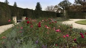 cair : Roses and lavender flowers in french formal garden of Chateau Lednice, South Moravia, Czech Republic. Flowering chateau Lednice park in autumn day. Lednice-Valtice Cultural Landscape