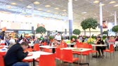 jantar : People have a rest and eat in cafe of a fast food in big shopping center Vídeos