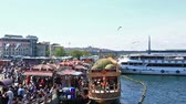 ahmet : Summer view at crowded Golden Horn, The Galata bridge, embankment and The Blue Mosque in sunny day.