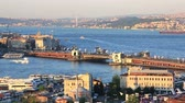 ahmet : Picturesque view of Golden Horn with The Galata bridge, calm sea and coast shore at background in sunny day. Stock Footage