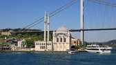 Scenic view at yachts on pier near Ottoman Neo-Baroque style Ortakoy Mosque and Bosphorus Bridge at distance Stock Footage