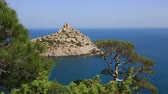 tourist ship swims in in the Blue bay in the New World, a view from the mountain Karaul Oba, Crimea Stock Footage