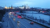 Cars are driving along the Moskva River embankment near the Moscow Kremlin, timelapse 4K Stock Footage