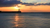 Colorful landscape with a lighthouse in Yalta at sunrise, Crimea Stock Footage