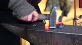 Blacksmith forges a horseshoe on the anvil