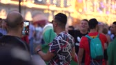 riso : Moscow, Russia, June 28, 2018 FIFA World Cup Russia 2018 Fans from all over the world are happy to meet Stock Footage