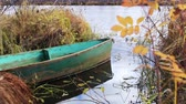 wood : Old boat on the autumn river