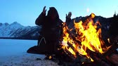 monastic : Monks franciscans are warming near fire in winter. Slowmotion 240FPS