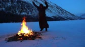 monastic : a mad monk dances around the campfire
