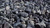 cascalho : Nature background from dark sea pebbles