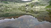 приозерный : Rocky peaks are reflected in a mountain lake. Western Siberia, Ergaki range.