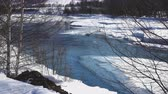 pellets : Frozen stream with ice. Spring river and snow. Cold water flows in the river ice.