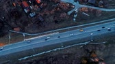 este : Traffic of cars on a highway at the evening. Aerial view. Stock mozgókép