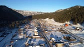 A beautiful aerial shot of winter village, mountain winter resort in Altai Stock Footage