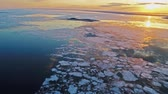 este : Bright colorful sunset over the frozen sea