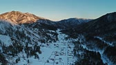 pente : A beautiful aerial shot of winter village, mountain winter resort in Altai Vidéos Libres De Droits