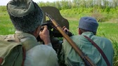 shoulder blades : Soldiers shoot from a machine gun HD Stock Footage