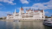 classic architecture : 4K footage of the Parliament in Budapest during a boat trip along the Danube River.