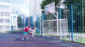 Dad and son play basketball. Healthy lifestyle.