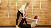 アーサナ : A yoga guru teaches a student yoga exercises.Slow Motion 動画素材