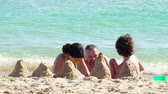 criança : 4K Happy family. Father playing sand with Cute Smiling little boy child and daughter on white sand beach on nature outdoor, Family travel, summer beach vacation with children concept.