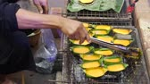 vendor : Grilled egg, street food, Thailand Stock Footage
