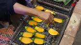 barbequed : Grilled egg, street food, Thailand Stock Footage