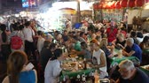 délkelet Ázsia : Bangkok, Thailand-November 3, 2018: People dining and bustling around China town of Bangkok. Yaowarat Road (China Town) is famous for street food with lively environment.