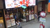 Hong Kong, Hong Kong S.A.R-June 3, 2017: Restaurant in Hong Kong. Pedestrians on the sidewalk in Hong Kong 動画素材