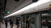yatılı : Hong Kong, Hong Kong S.A.R.-June 3, 2017: Commuters in subway station in Hong Kong Stok Video