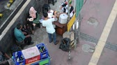 ベンダー : View of street food on the sidewalk in Bundung, Indonesia. People and street food vendors are around the area.