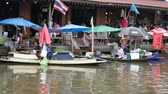 vendor : Samut Songkhram, Thailand-September 12, 2015: Floating Market, Thailand. Amphawa Floating Market. It is one of the most popular floating markets in Thailand. Some vendors sell food on their boats. There are also many food stalls, restaurants and shops alo Stock Footage