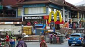 mcdonalds : Chiang Mai, Thailand-October 4, 2015: MCdonals restaurant and Traffic in Chiang Mai, Thailand Stock Footage