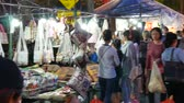 délkelet Ázsia : Chiang Mai, Thailand-October 4, 2015: Tourists and locals walk among stalls at the famous Sunday walking street (Thapae walking street), Chiang Mai, Thailand.