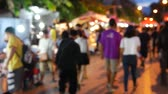 domorodý : Tourists and locals walk among stalls at the famous Sunday walking street (Thapae walking street), Chiang Mai, Thailand.