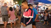 atividades : Chiang Mai, Thailand-October 4, 2015: Tourists and locals walk among stalls at the famous Sunday walking street (Thapae walking street), Chiang Mai, Thailand.