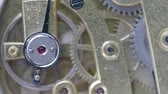 rubi : macro shot - movement of running retro brass mechanical watch with focus on ruby ??stone on foreground