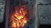 pec : hot coals in a forge in a rural rural smithy outdoors