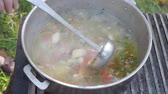 mutton : shurpa (Chorba) Central Asian soup from lamb meat and large-slicedvegetables in pot on an outdoor oven