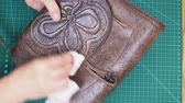 simir : craftsmanship craftsmanship making the carved leather bag - craftsman polishes